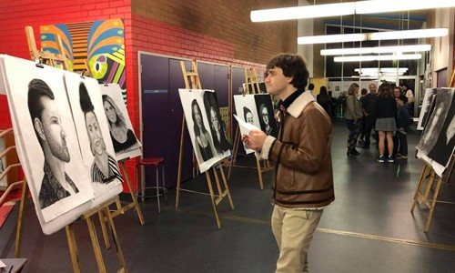 2018 Teacher Portrait Prize Exhibition being judged by a past student